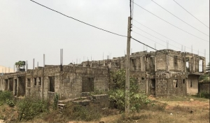 100 By 100 With Uncompleted Twin 4 Flats Mixed Land for Sale Oredo Edo Vetra  Property